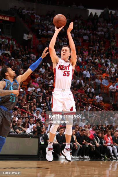 Duncan Robinson of the Miami Heat shoots three point basket against the Dallas Mavericks on March 28 2019 at American Airlines Arena in Miami Florida...