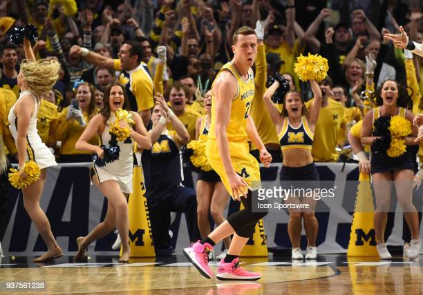 Duncan Robinson of the Michigan Wolverines celebrates after sinking a three pointer during the NCAA Division I Men's Championship Elite Eight round...