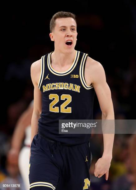 Duncan Robinson of the Michigan Wolverines celebrates his three point shot in the first half against the Nebraska Cornhuskers during quarterfinals of...