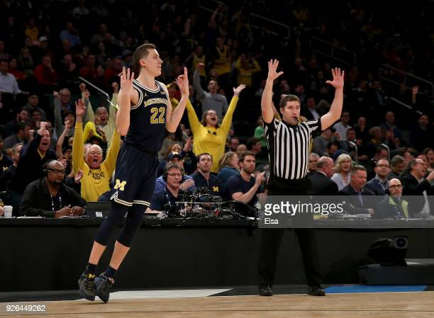 Duncan Robinson of the Michigan Wolverines celebrates his three point shot in the second half against the Nebraska Cornhuskers during quarterfinals...