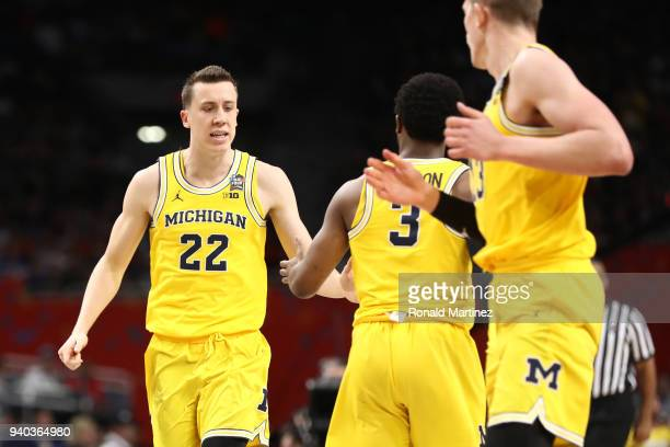 Duncan Robinson of the Michigan Wolverines celebrates the play against the Loyola Ramblers in the second half during the 2018 NCAA Men's Final Four...