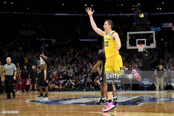 Duncan Robinson of the Michigan Wolverines celebrates the Wolverines 5854 win against the Florida State Seminoles in the 2018 NCAA Men's Basketball...