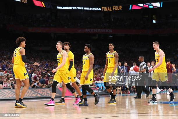 Duncan Robinson of the Michigan Wolverines celebrates with teammates in the second half against the Loyola Ramblers during the 2018 NCAA Men's Final...
