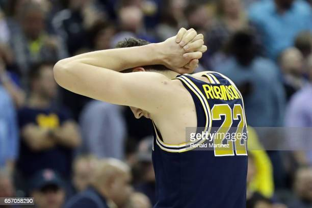 Duncan Robinson of the Michigan Wolverines reacts after being defeated by the Oregon Ducks 6968 during the 2017 NCAA Men's Basketball Tournament...
