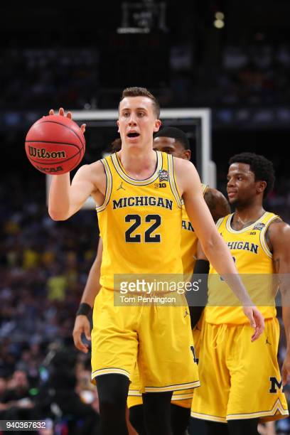 Duncan Robinson of the Michigan Wolverines reacts against the Loyola Ramblers in the second half during the 2018 NCAA Men's Final Four Semifinal at...