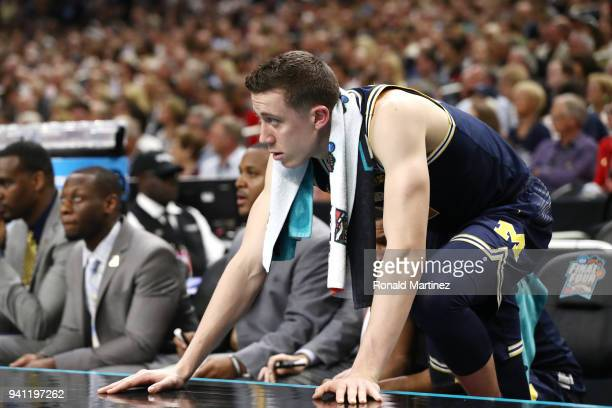 Duncan Robinson of the Michigan Wolverines reacts from the sideline against the Villanova Wildcats in the first half during the 2018 NCAA Men's Final...