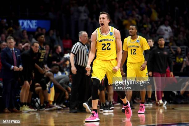 Duncan Robinson of the Michigan Wolverines reacts in the second half while taking on the Florida State Seminoles in the 2018 NCAA Men's Basketball...