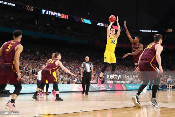 Duncan Robinson of the Michigan Wolverines shoots against Donte Ingram of the Loyola Ramblers in the second half during the 2018 NCAA Men's Final...