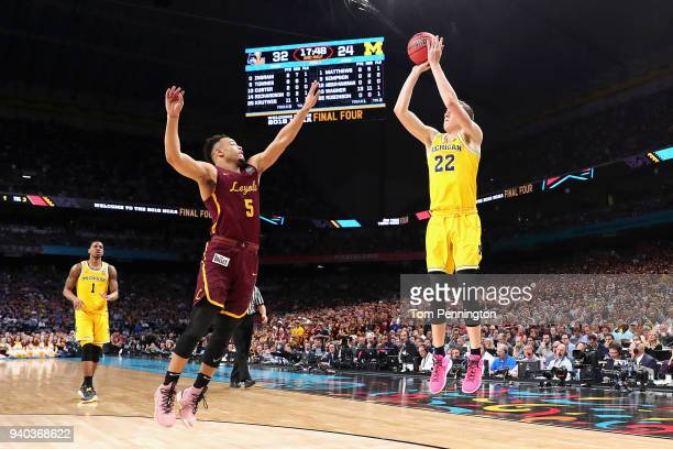 Duncan Robinson of the Michigan Wolverines shoots against Marques Townes of the Loyola Ramblers in the second half during the 2018 NCAA Men's Final...