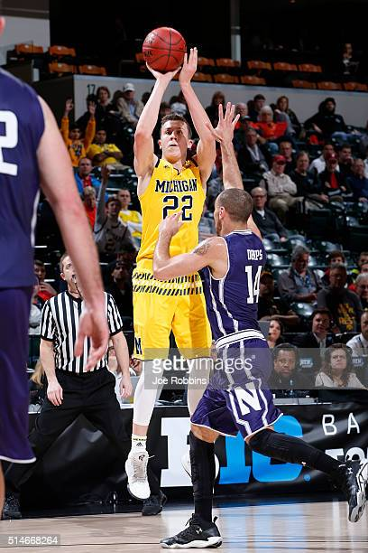 Duncan Robinson of the Michigan Wolverines shoots against the Northwestern Wildcats in the second round of the Big Ten Basketball Tournament at...