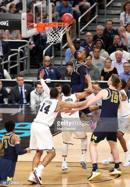 Duncan Robinson of the Michigan Wolverines shoots the ball against the Villanova Wildcats during the first half in the 2018 NCAA Photos via Getty...