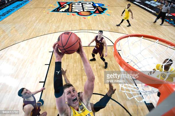 Duncan Robinson of the Michigan Wolverines shoots the ball during the first half against the Loyola Ramblers in the 2018 NCAA Photos via Getty Images...