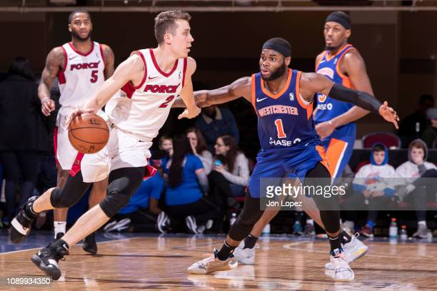 Duncan Robinson of the Sioux Falls Skystorm dribbles the ball against the defense of the Westchester Knicks during an NBA GLeague game on January 26...