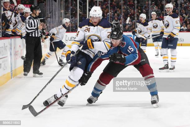 Duncan Siemens of the Colorado Avalanche defends against Hudson Fasching of the Buffalo Sabres at the Pepsi Center on December 5 2017 in Denver...