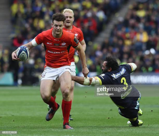 Duncan Taylor of Saracens breaks past Davit Zirakashvili during the European Rugby Champions Cup Final between ASM Clermont Auvergen and Saracens at...