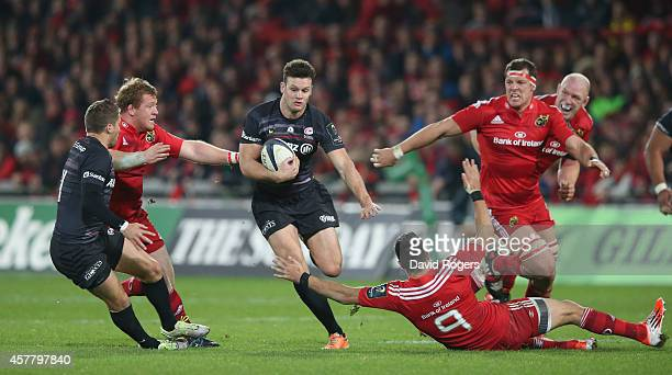 Duncan Taylor of Saracens breaks with the ball during the European Rugby Champions Cup match between Munster and Saracens at Thomond Park on October...
