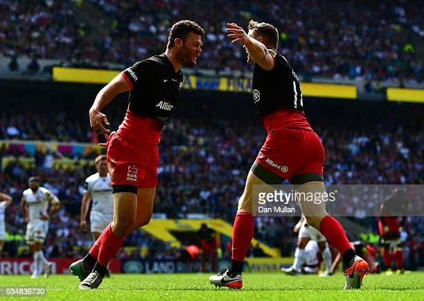 Duncan Taylor of Saracens celebrates scoring his team's first try with Chris Ashton of Saracens during the Aviva Premiership final match between...