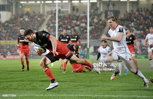 Duncan Taylor of Saracens goes over for a try chased by Andrew Trimble of Ulster during the European Champions Cup Pool 1 rugby game at Kingspan...