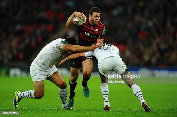 Duncan Taylor of Saracens is halted by the Toulouse defence during the Heineken Cup pool three match between Saracens and Toulouse at Wembley Stadium...