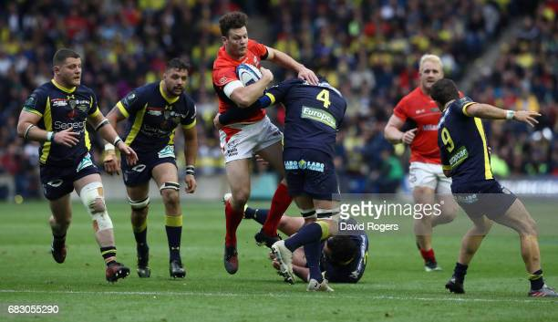 Duncan Taylor of Saracens is tackled by Arthur Iturria during the European Rugby Champions Cup Final between ASM Clermont Auvergen and Saracens at...