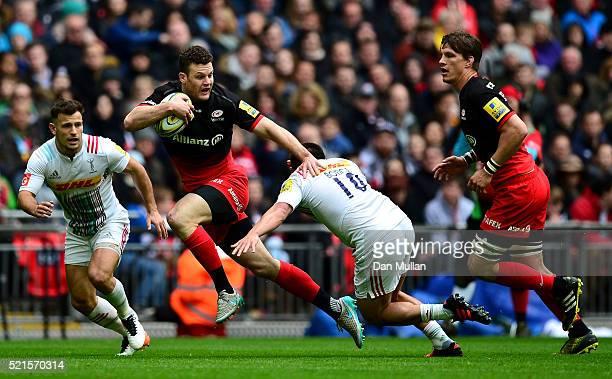 Duncan Taylor of Saracens is tackled by Ben Botica of Harlequins during the Aviva Premiership match between Saracens and Harlequins at Wembley...