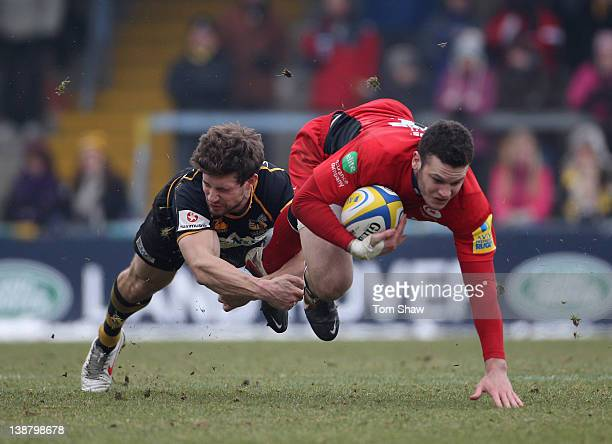 Duncan Taylor of Saracens is tackled by Dominic Waldouck of Wasps during the Aviva Premiership match between London Wasps v Saracens at Adam Park on...