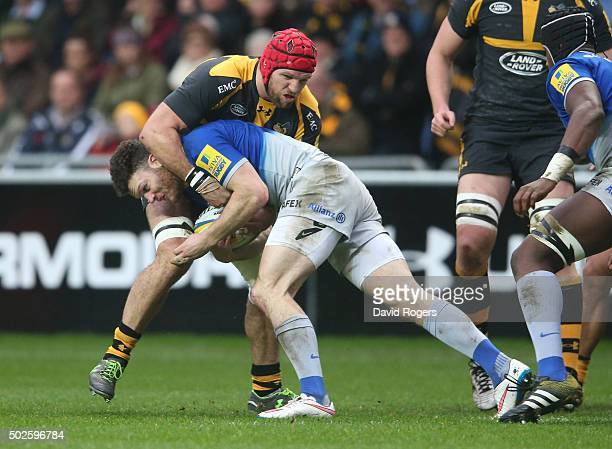 Duncan Taylor of Saracens is tackled by James Haskell during the Aviva Premiership match between Wasps and Saracens at The Ricoh Arena on December...