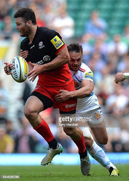 Duncan Taylor of Saracens is tackled by Phil Dollman of Exeter Chiefs during the Aviva Premiership final match between Saracens and Exeter Chiefs at...