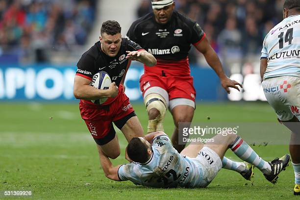 Duncan Taylor of Saracens is tackled by Remi Tales of Racing 92 during the European Rugby Champions Cup Final match between Racing 92 and Saracens at...
