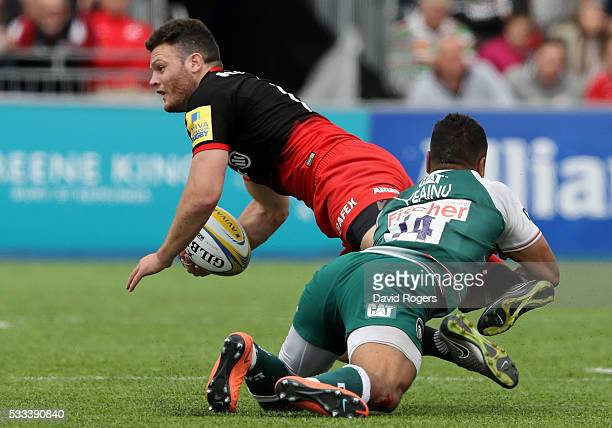 Duncan Taylor of Saracens is tackled by Telusa Veainu during the Aviva Premiership semi final match between Saracens and Leicester Tigers at Allianz...