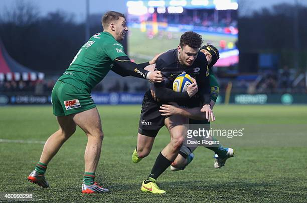 Duncan Taylor of Saracens is tackled during the Aviva Premiership match between Saracens and London Irish at Allianz Park on January 3 2015 in Barnet...