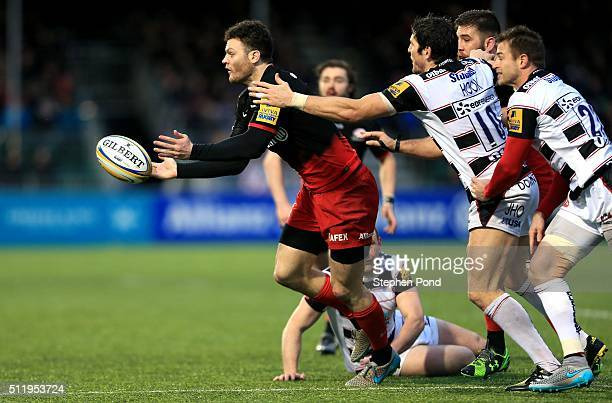 Duncan Taylor of Saracens passes under pressure during the Aviva Premiership match between Saracens and Gloucester Rugby at Allianz Park stadium on...