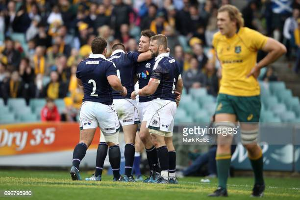 Duncan Taylor of Scotland celebrates with his team mates after scoring a try during the International Test match between the Australian Wallabies and...