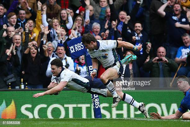 Duncan Taylor of Scotland dives over to score his team's second try during the RBS Six Nations match between Scotland and France at Murrayfield...