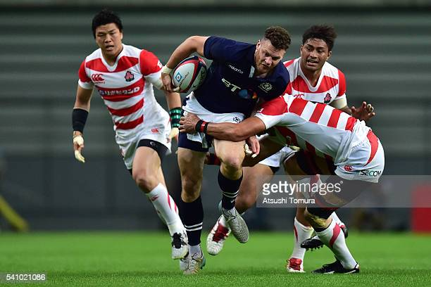 Duncan Taylor of Scotland is tackled during the international friendly match between Japan v Scotland at Toyota Stadium on June 18, 2016 in Toyota,...