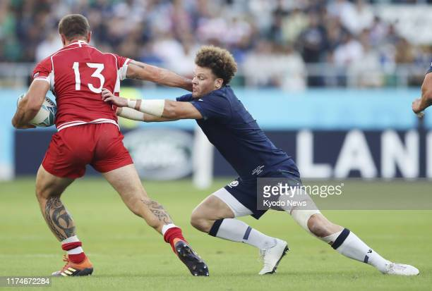 Duncan Taylor of Scotland tackles Vladimir Ostroushko of Russia during the first half of a Rugby World Cup Pool A match on Oct. 9, 2019.