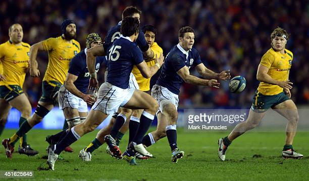 Duncan Taylor of Scotland tries to out run pressure from the Australian forwards during the Scotland v Australia Autumn International Series Match at...