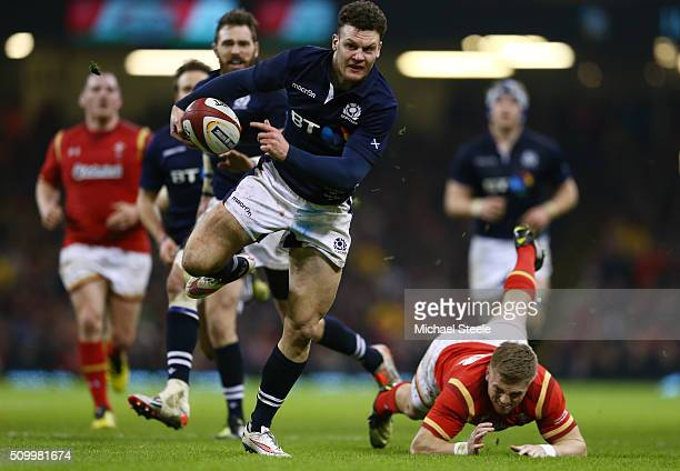 Duncan Taylor of Scotland wrong foots Gareth Anscombe of Wales to score his team's second try during the RBS Six Nations match between Wales and...