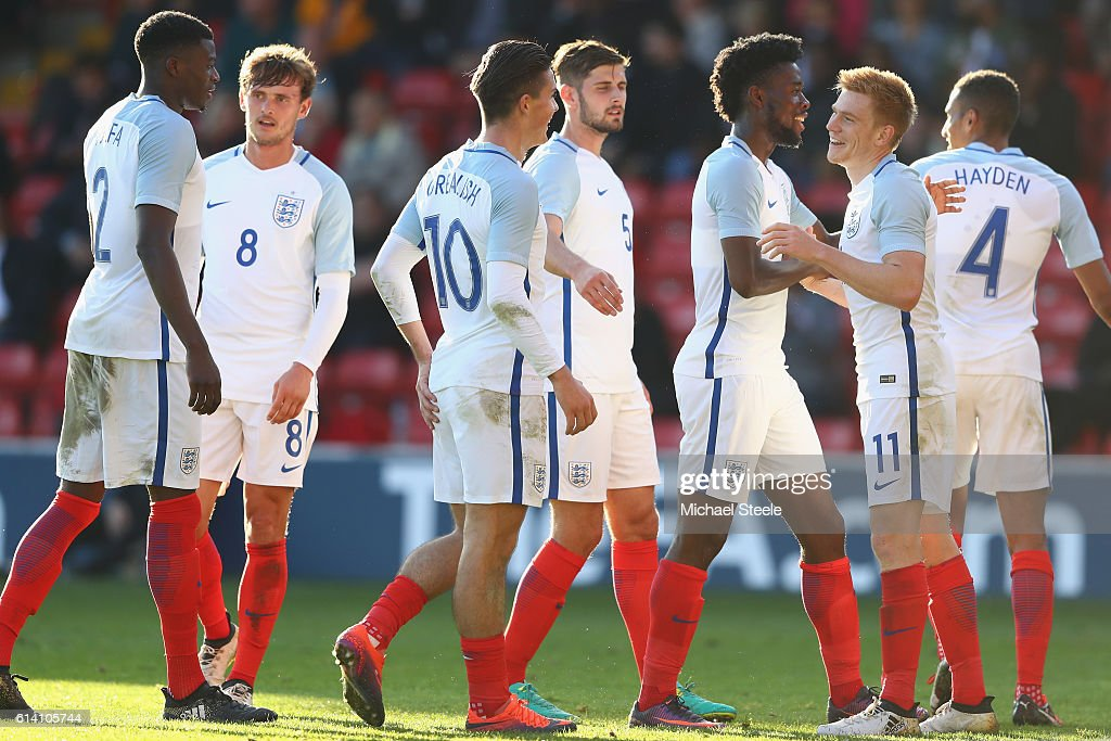 Duncan Watmore (R) of England celebrates his goal alongside Joshua Onomah (2R) during the UEFA European U21 Championship Group 9 match between England and Bosnia Herzegovina at Banks' Stadium on October 11, 2016 in Walsall, England.