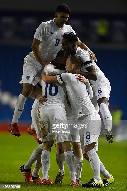 Duncan Watmore of England is swamped by team mates after scoring during a European Under 21 Qualifier between England U21 and Switzerland U21 at Amex...