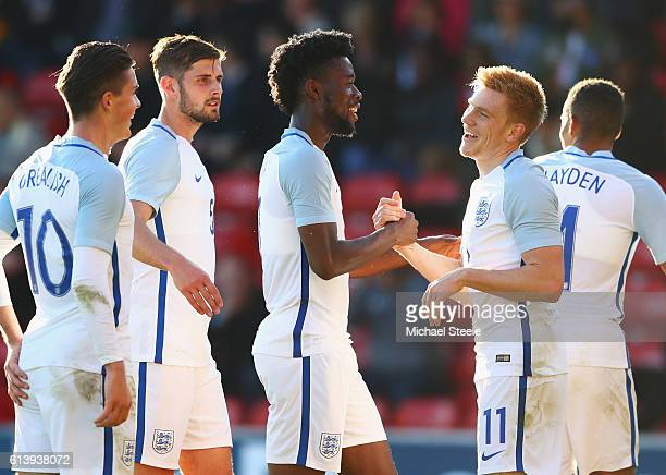 Duncan Watmore of England U21 celebrates with Josh Onomah and team mates as he scores their fourth goal during the UEFA European U21 Championship...