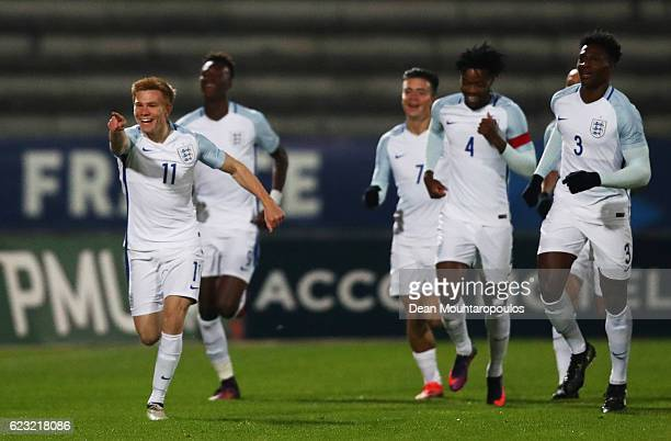 Duncan Watmore of England U21 celebrates with team mates as he scores their first goal during the U21 international friendly match between France and...