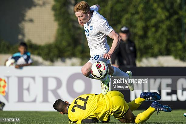 Duncan Watmore of England U21 goalkeeper Ahmed Reda Tagnaouti of Morocco U21 during the Festival International Espoirs de Football tournament match...