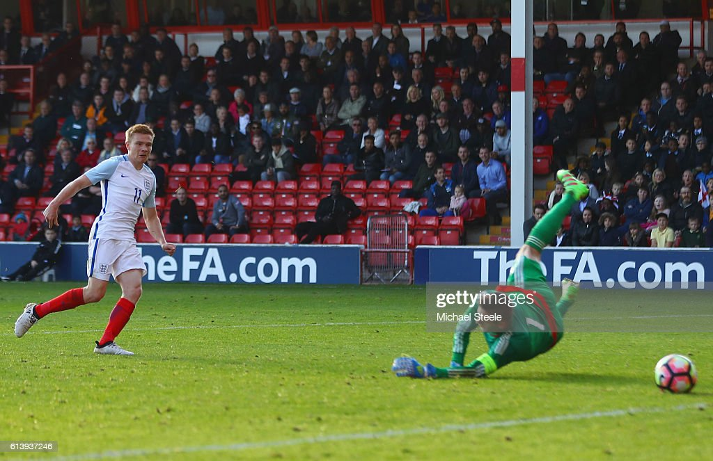 Duncan Watmore of England U21 scores their fourth goal past goalkeeper Kenan Piric of Bosnia and Herzegovina U21 during the UEFA European U21 Championship Group 9 qualifying match between England and Bosnia and Herzegovina at Banks' Stadium on October 11, 2016 in Walsall, England.