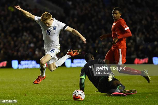 Duncan Watmore of England wins a penalty as he is brought down by goalkeeper Yvon Nganoma of Switzerland during a European Under 21 Qualifier between...