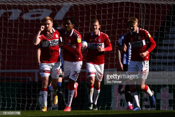 Duncan Watmore of Middlesbrough celebrates with Djed Spence after scoring their team's third goal during the Sky Bet Championship match between...