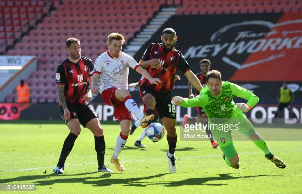 Duncan Watmore of Middlesbrough is challenged by Steve Cook, Cameron Carter-Vickers and Asmir Begovic of AFC Bournemouth during the Sky Bet...