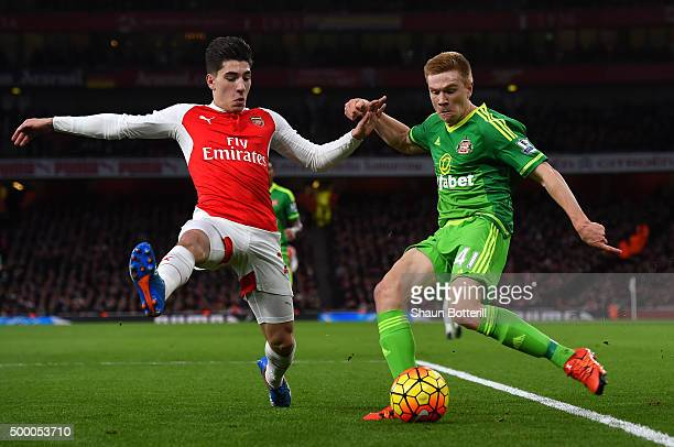 Duncan Watmore of Sunderland and Hector Bellerin of Arsenal compete for the ball during the Barclays Premier League match between Arsenal and...