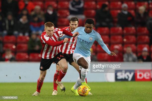 Duncan Watmore of Sunderland and Jayden Braaf in action during the Checkatrade Trophy Quarter Final match between Sunderland and Manchester City...