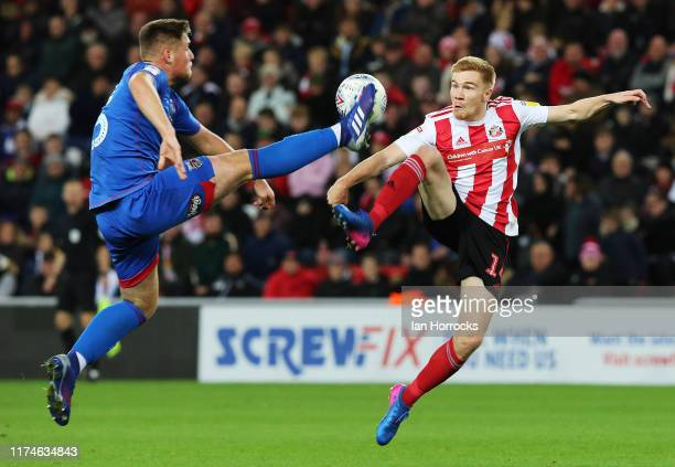 Duncan Watmore of Sunderland goes up for the ball withMattie Pollock of Grimsby during the Leasing.com cup between Sunderland and Grimsby at Stadium...